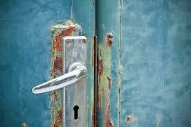 aged photograph old rusty door handle by maratsavalai lertsirivilai