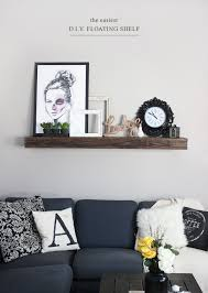 view in gallery floating shelf above sofa