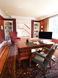 traditional home office design. Traditional Home Office With Crown Molding, Red Walls, White Trims, Built-in Shelving And A Large Oriental Rug On Hardwood Flooring. Design R
