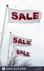 Sale Signs Blowing In A Post Christmas Breeze Stock Photo 77470344
