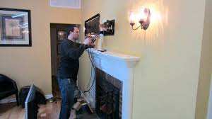 installing tv above fireplace wiring hiding wires for over fireplace part large size of hang tv
