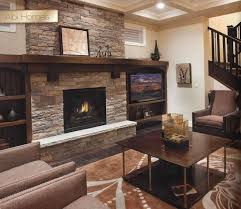 beige and chocolate stack stone wall fireplace with black frame and glass box brown furnished wood wall mounted fireplace mantel dark brown furnished wood