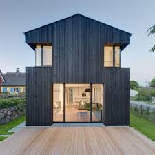 house wieckin by möhring architekten features black painted walls and deep corner windows