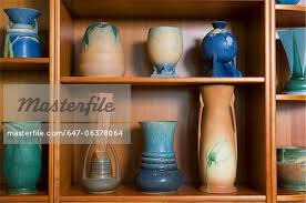 collection display shelf display of roseville s futura art pottery made only in the year 1928 highly sought stock photo