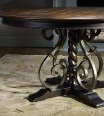 mahogany dining table shown leaves seats  and splay legs come together for romantic italian ambience in the tre