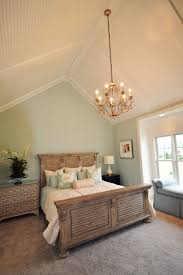 seaside master bedroom with vaulted ceiling with low