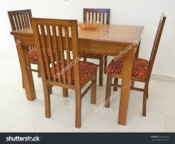 Against The Wall Dining Table Dining Table And Four Chairs In An Apartment Against White Wall