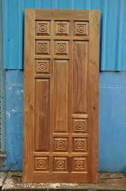 Wooden door designing Solid Wood Door Design 01 Triangle Homez Kerala Door Designs Window Designs Latest Doors And Windows Desings