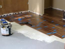 floor adhesive being added to the hardwood floor