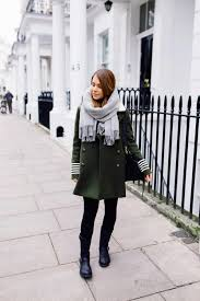 marianna mäkelä is rocking the military trend in a double ted khaki coat with striped