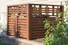 the cedar slats are angled to give a louvered look and allow for essential air flow to the a c unit