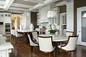 elegant eat in kitchen with traditional white cabinetry peter rno