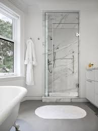 the master bedroom also has a marble clad ensuite bathroom