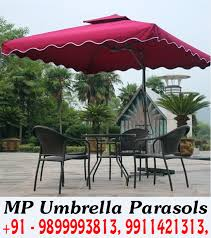outdoor restaurant tables with umbrellas