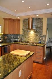 maple kitchen cabinets with black appliances. Wood Floor With Light Maple Cabinets. Too Much Mixing Of Materials For My Taste But Kitchen Cabinets Black Appliances
