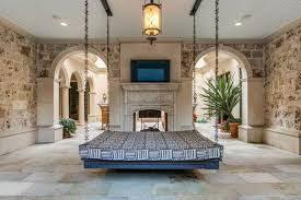 ... this thoroughly ridiculous $13.75 million Dallas mansion, but the thing  that first caught our eye is the bed hanging from the (enormously high)  ceiling ...