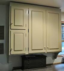 thinking that a clear coat would solve this i emailed rustoleum to make sure their water based polyurethane could be used over newly painted cabinets