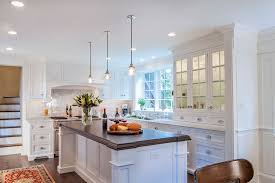 window tinting lancaster pa with traditional kitchen also dark wood countertop glass front cabinets glass pendant light recessed lighting white countertop