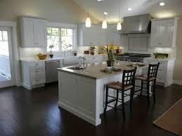 Sleek Kitchen With White Cabinet Also Dark Brown Laminate Floor Also