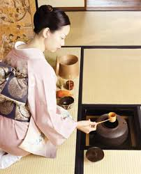 Photograph A woman practices the traditional Japanese art of the tea ceremony  Kids Britannica