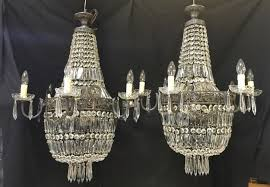 a pair of large french empire antique chandeliers