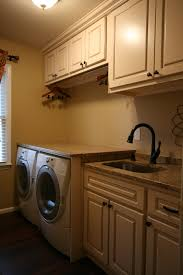 small basement laundry room after makeover lighting ideas with white wall interior color paint and wood wall mounted cabinet and washing machine with washer