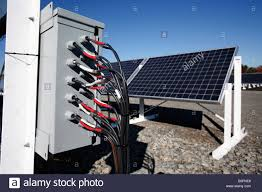 electrical wires enter a junction box on the site of a solar how to install solar panel system pdf at Solar Panel Box Wiring