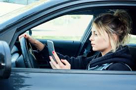 Of Hand-held Parents With Central While Use Young Parent Phones Kids Their Cell Half Penn Driving