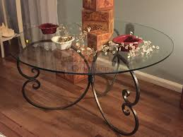 handmade coffee table with forged iron base round glass top