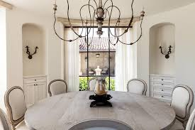 round terranean dining room with arched alcoves