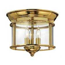 traditional polished brass flush ceiling light with seeded glass shade