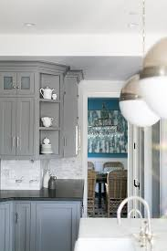 gray kitchen cabinets with honed black countertops