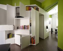 compact furniture for small spaces. Green Wall With White Quirky Shelves On The Grey Floor Garage Apartment Space Saving Ideas Modern. Best Office Furniture For Small Spaces . Compact