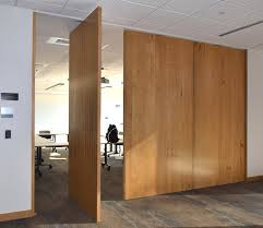 interior sliding door track which can be a combination of top hung sliding door and floor sliding track system when used as noise cancelling panels