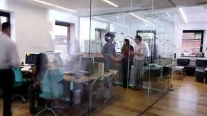 office building interior busy. Delighful Office Working Together Time Lapse Shot Of A Young And Attractive Business  Team Mixed Ethnicity For Office Building Interior Busy T