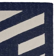striped border indoor outdoor rug navy
