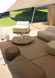 lovely sleek modern outdoor living area decorated in taupes whites and warm woods paola lenti
