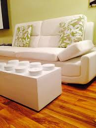 it looks just like a giant lego brick that you can put your feet up on or rest your glass on forget ordinary coffee tables lego is where it s at