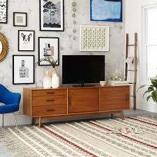 A gallery wall and a mid-century media console make for the ...