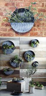 round galvanized metal wall pocket planter to view additional images