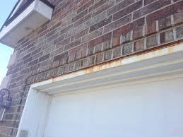 rust on exterior trim above garage garage door jpg