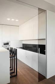 interior sliding glass door. Minimalist White Kitchen Separated With Dark Glass Sliding Doors Interior Door