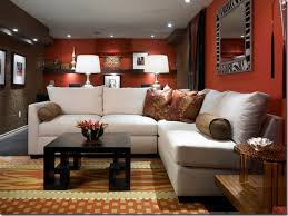 cute red paint living room walls white fabric sectional sofa black painted wood coffee table orange