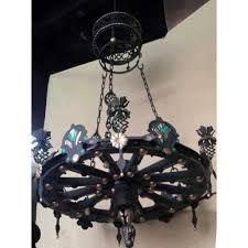 wheel wagon medallion wrought iron chains chandelier