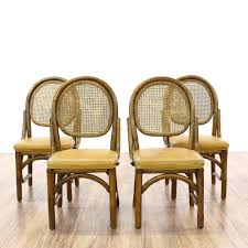 set of 4 dining chairs. This Set Of 4 Dining Chairs Are Featured In A Rattan With Dark Stained Finish. These Bohemian Have Round Woven Cane Backs, Curved A\u2026