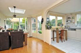 Kitchen Living Space Slide In Range Vent Hood Black Cabinets Cream Sofa Orange Cushion