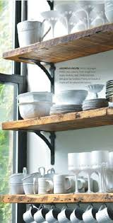 Barn wood or rustic shelving with black hardware for extra storage in  kitchen