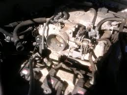 propper throttle body adjustment including iac pics there are four 12mm bolts holding this to the upper intake manifold you will also have to disconnect the inlet and outlet coolant lines connected to