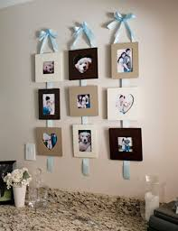 tips and tricks for hanging photos and frames pretty and functional ribbon hanging frames