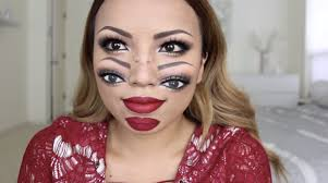 she started off with regular eye makeup and red lipstick then re drew her eyebrows and eyes on her cheeks